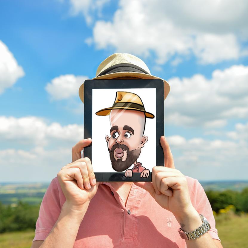 Une homme tenant avec ses deux main, devant sa tête une teblette grphique ( ipad ) sur laquelle on peut voir sa caricature digitale. L'homme porte un chapeau , une chemise rose-rouge et il a une barbe.